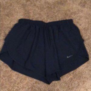Navy blue Nike DriFit shorts
